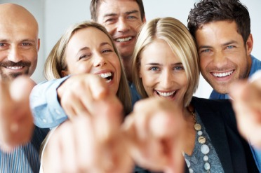 photodune-652445-cheerful-business-people-pointing-at-you-copyspace-xs
