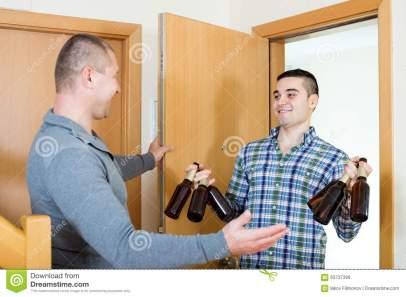visit-friend-who-brought-beer-happy-adult-men-visiting-bringing-beverage-63737399
